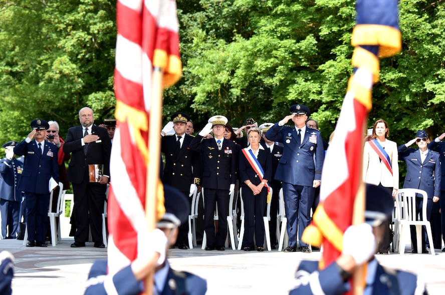 PARIS – U.S. Air Force Gen. Frank Gorenc, U.S. Air Forces in Europe-Air Forces Africa commander, Christiane Barody-Weiss, Mayor of Marnes-la-Coquette, France, French Gen. Bernard Schuler, French Strategic Air Forces Command commander, and Mr Yann Jounot, Prefect of the Hauts-de-Seine, render honors during the American National Anthem in a Memorial Day ceremony at the Lafayette Escadrille Memorial, in Marnes-la-Coquette, France, May 28, 2016.  Each offered a speech commemorating the shared sacrifices of French and American force, and recognizing the enduring relationship the two countries have maintained for more than 240 years.(U.S. Air Force photo by Senior Master Sgt. Brian Bahret/Released)