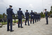 Airmen participate in a ceremony honoring fallen service members at the Luxembourg American Cemetery and Memorial in Luxembourg, May 28, 2016. Hundreds gathered to pay respects at the cemetery, which serves as the final resting place for more than 5,000 service members. Army photo by Spc. Tracy McKithern
