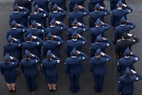 Service members salute during a ceremony for Memorial Day at Yokota Air Base, Japan, May 27, 2016. The 374th Airlift Wing hosted the ceremony. Air Force photo by Yasuo Osakabe