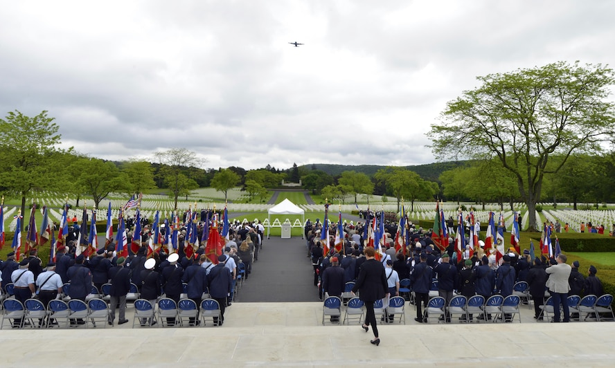 A 37th Airlift Squadron C-130J Super Hercules flies over a Memorial Day ceremony May 29, 2016, at Lorraine American Cemetery and Memorial, in St. Avold, France. The flyover renders honors to those buried in the cemetery. (U.S. Air Force photo/Staff Sgt. Sharida Jackson)