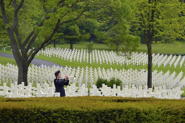 A bugler from the 16th Sustainment Brigade plays Taps during a Memorial Day ceremony May 29, 2016, at Lorraine American Cemetery and Memorial, in St. Avold, France. The cermony honored the sacrifices of fallen American servicemembers. (U.S. Air Force photo/Staff Sgt. Sharida Jackson)