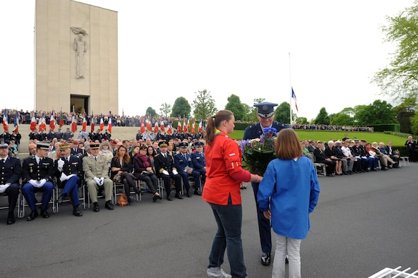 French Girl Scout members present a wreath to Brig. Gen. Jon Thomas, 86th Airlift Wing commander, during a Memorial Day ceremony May 29, 2016, at Lorraine American Cemetery and Memorial, in St. Avold, France. Memorial Day commemorates fallen servicemembers. (U.S. Air Force photo/Staff Sgt. Sharida Jackson)