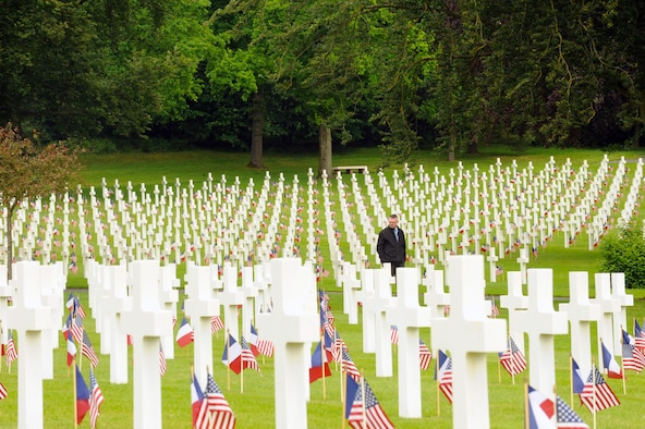 Mr. Philip George, 21st Theater Sustainment Company mortuary affairs, views gravesites during a Memorial Day ceremony May 29, 2016 at Lorraine American Cemetery and Memorial, in St. Avold, France. More than 10,000 Americans are buried in the cemetery, the largest American WWII cemetery in Europe. (U.S. Air Force photo/Staff Sgt. Sharida Jackson)