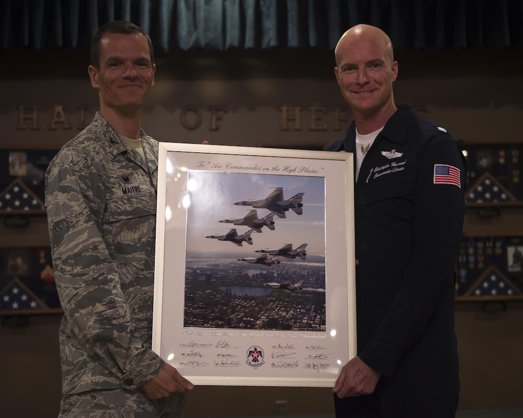 Col. Ben Maitre, 27th Special Operations Wing commander, accepts a Thunderbirds lithograph from Thunderbird 1, Lt. Col. Christopher Hammond, May 27, 2016 at Cannon Air Force Base, N.M. The 2016 Cannon Air Show highlights the unique capabilities and qualities of Cannon's Air commandos and also celebrates the long-standing relationship between the 27th Special Operations Wing and the High Plains community. (U.S. Air Force photo/Airman 1st Class Kai White)