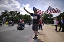 A spectator shows support during the Rolling Thunder demonstration ride in Washington, D.C., May 29, 2016. The annual motorcycle ride and rally, held the day before Memorial Day, draws veterans of all eras and others seeking to pay respects to those who have served. Air National Guard photo by Staff Sgt. Christopher S. Muncy
