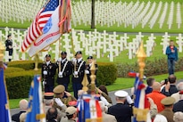 Soldiers assigned to the 16th Sustainment Brigade present the colors during a Memorial Day ceremony at Lorraine American Cemetery in St. Avold, France, May 29, 2016. The cemetery is the final resting place for more than 10,000 Americans who gave their lives in World War II. Air Force photo by Staff Sgt. Sharida Jackson
