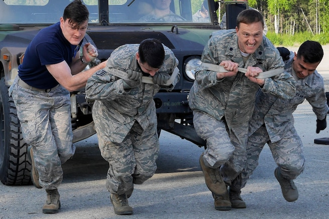 Air Force personnel pull a vehicle during the 673d Security Forces National Police Week skills competition at Joint Base Elmendorf-Richardson, Alaska, May 19, 2016. The airmen are assigned to the 673d Medical Group. Air Force photo by Senior Airman Kyle Johnson