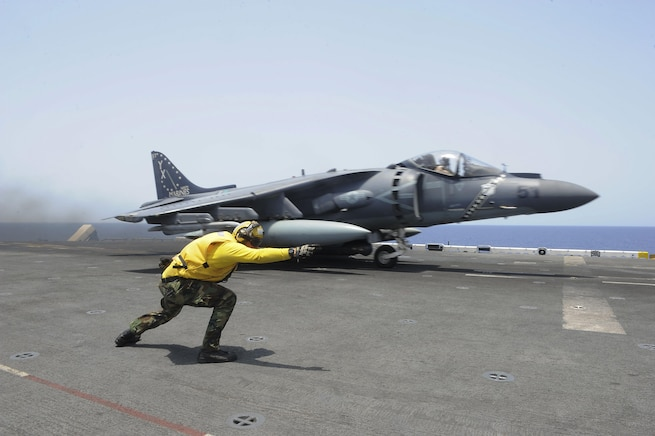 Navy Petty Officer 3rd Class Chase Coker launches a Marine Corps AV-8B Harrier II off the flight deck of the USS Boxer in the Gulf of Aden, May 23, 2016. Coker is an aviation boatswain's mate. Navy photo by Petty Officer 2nd Class Jose Jaen