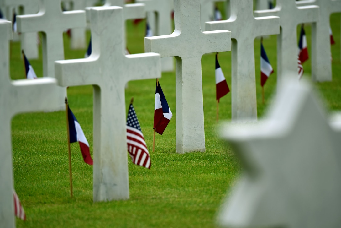 U.S. and French flags line the graves at the Suresnes American Cemetery in a Memorial Day ceremony, May 29, 2016.  The cemetery is the final resting place for 1,565 Americans who fought and died in France during WWI and WWII.  More than 200 civilians, military members and official delegates from Poland, Vietnam, Japan, Germany, France and the United States attended the event. (U.S. Air Force photo by Senior Master Sgt. Brian Bahret/Released)