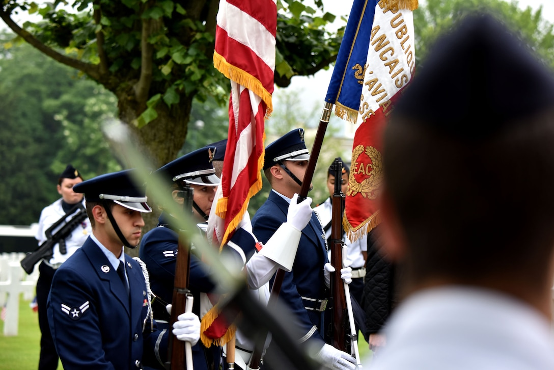 An honor guard, composed of Airmen from Ramstein Air Base, Germany, and the French air force, post the colors during a Memorial Day ceremony at the Suresnes American Cemetery in a Memorial Day Ceremony, May 29, 2016. During the ceremony, speakers honored the shared sacrifices of U.S. and French service members fighting for each other's freedom and security in a relationship that began more than 240 years ago in the American Revolutionary War. The cemetery is the final resting place for 1,565 Americans who fought and died in France during WWI and WWII.  More than 200 civilians, military members and official delegates from Poland, Vietnam, Japan, Germany, France and the United States attended the event. (U.S. Air Force photo by Senior Master Sgt. Brian Bahret/Released)