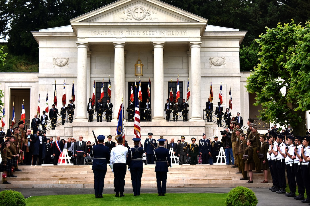 An Honor Guard comprised of Airmen from Ramstein Air Base, Germany, and the French air post the colors during a Memorial Day Ceremony at the Suresnes American Cemetery, May 29, 2016.  During the ceremony speakers honored fallen servicemembers and acknowled the enduring relationship the two countries forged during the American Revolutionary War. The cemetery is the final resting place for 1,565 Americans who fought and died in France during WWI and WWII.  More than 200 civilians, military members and official delegates from Poland, Vietnam, Japan, Germany, France and the United States attended the event. (U.S. Air Force photo by Senior Master Sgt. Brian Bahret/Released)