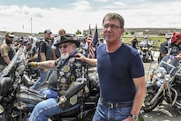 Defense Secretary Ash Carter talks with participants of the Rolling Thunder motorcycle ride at the start of the event at the Pentagon, May 29, 2016. The annual ride aims to raise awareness for prisoners of war and U.S. service members missing in action. DoD photo by Army Sgt. First Class Clydell Kinchen