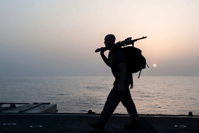 A Marine participates in a sunrise ruck march honoring fallen service members as he marks Memorial Day on the flight deck of the USS Boxer in the Gulf of Aden, May 28, 2016. Navy photo by Seaman Eric Burgett