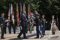 President Barack Obama places a wreath at the Tomb of the Unknown Soldier during a Memorial Day ceremony at Arlington National Cemetery in Arlington, Va., May 30, 2016. DoD photo by Air Force Senior Master Sgt. Adrian Cadiz