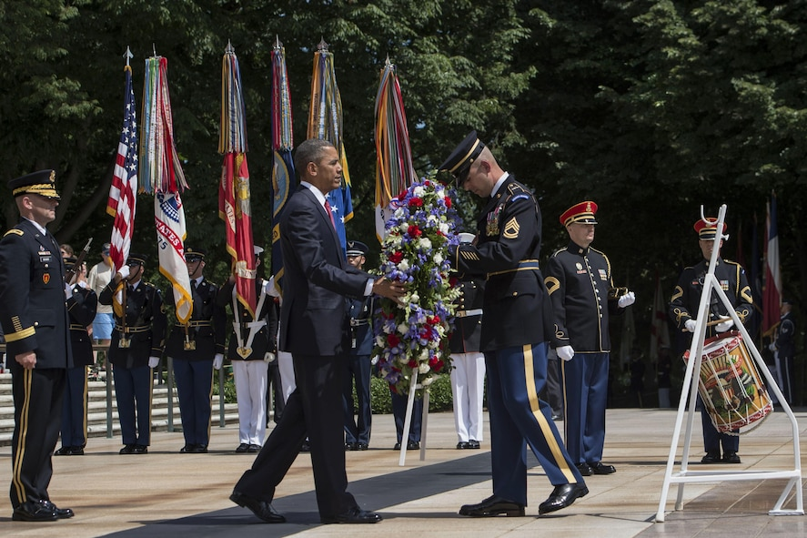 President Barack Obama placing a wreath at the Tomb of the Unknown Soldier.