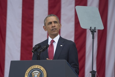 President Barack Obama delivering remarks at a podium.