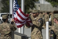 Members of the honor guard prepare to fold the flag during the Memorial Day remembrance ceremony at Bagram Airfield, Afghanistan, May 30, 2016. Air Force photo by Tech. Sgt. Tyrona Lawson