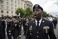 Sgt. 1st Class Ronald English, a U.S. Army Reserve Soldier with the 200th Military Police Command, leads a formation of roughly a hundred Soldiers along Constitution Avenue in the 2016 National Memorial Day Parade in Washington, D.C., May 30. U.S. Army Reserve Soldiers in formation were represented by the 200th MP Cmd., from Fort Meade, Maryland; the 55th Sustainment Brigade, from Fort Belvoir, Virginia; and the Military Intelligence Readiness Command, from Fort Belvoir. (U.S. Army photo by Master Sgt. Michel Sauret)