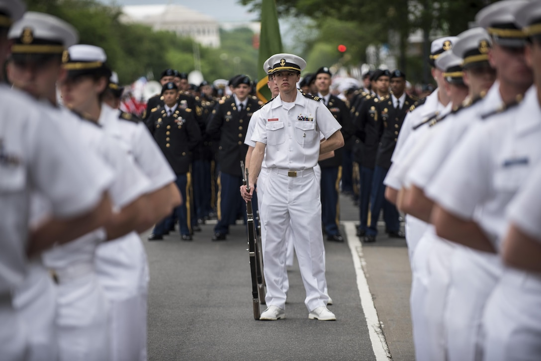 Members of the Regimental Band and Honor Guard, Massachusetts Maritime Academy, stand in formation on Constitution Avenue during the 2016 National Memorial Day Parade in Washington, D.C., May 30. (U.S. Army photo by Master Sgt. Michel Sauret)