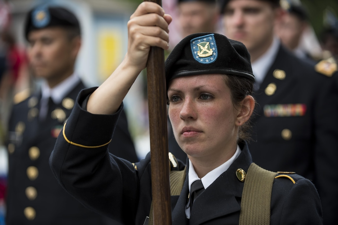 Sgt. Brittany Albanese, with the 443rd Military Police Command, holds the guidon for the 200th Military Police Command during a march along Constitution Avenue in the 2016 National Memorial Day Parade in Washington, D.C., May 30. The Soldiers in formation were from the 200th MP Cmd., from Fort Meade, Maryland; the 55th Sustainment Brigade, from Fort Belvoir, Virginia; and the Military Intelligence Readiness Command, from Fort Belvoir. (U.S. Army photo by Master Sgt. Michel Sauret)