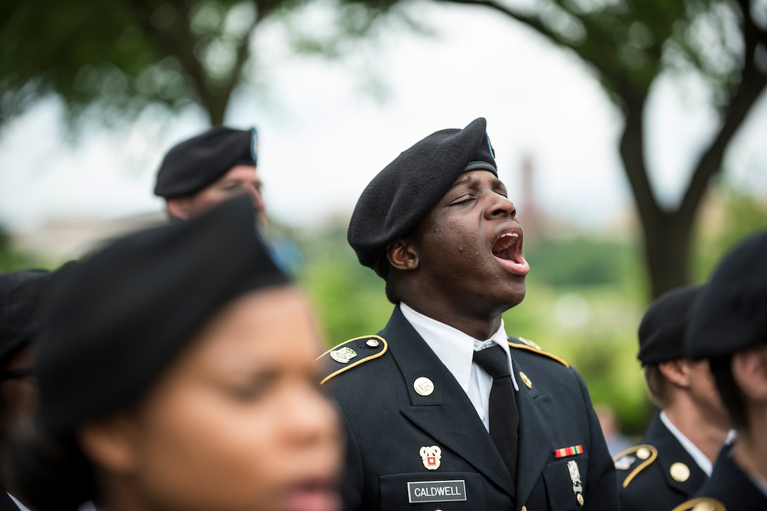 A U.S. Army Reserve Soldier from the 200th Military Police Command, from Fort Meade, Maryland, calls out cadence in formation while marching along Constitution Avenue in the 2016 National Memorial Day Parade in Washington, D.C., May 30. Other Soldiers in formation were from the 55th Sustainment Brigade, from Fort Belvoir, Virginia; and the Military Intelligence Readiness Command, from Fort Belvoir. (U.S. Army photo by Master Sgt. Michel Sauret)