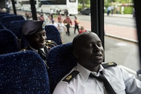 Sgt. 1st Class Ivo Degoh, U.S. Army Reserve Soldier with the 200th Military Police Command, takes a breather in an air-conditioned bus to cool off from the afternoon march along Constitution Avenue in the 2016 National Memorial Day Parade in Washington, D.C., May 30. Approximately a hundred U.S. Army Reserve Soldiers marched in the parade, represented by the 200th MP Cmd., from Fort Meade, Maryland; the 55th Sustainment Brigade, from Fort Belvoir, Virginia; and the Military Intelligence Readiness Command, from Fort Belvoir. (U.S. Army photo by Master Sgt. Michel Sauret)(U.S. Army photo by Master Sgt. Michel Sauret)