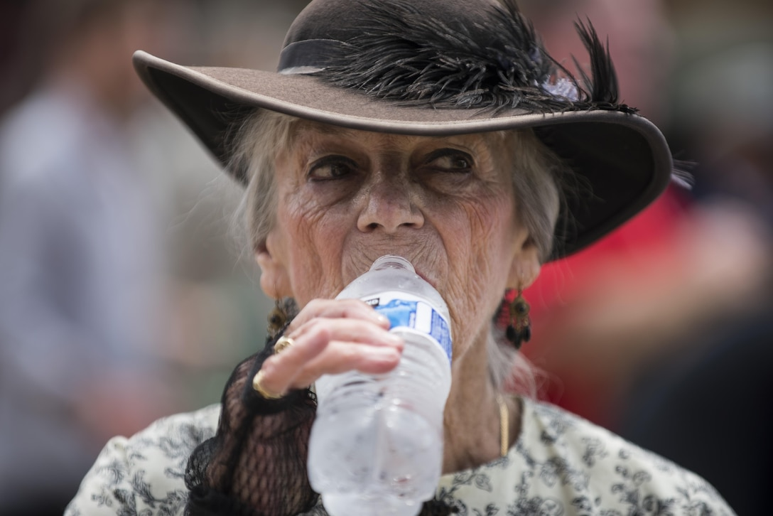 Liz Groszner, member of the historical organization called Order of the Confederate Rose, takes a drink of water to cool off from the afternoon heat before the start of the 2016 National Memorial Day Parade in Washington, D.C., May 30. (U.S. Army photo by Master Sgt. Michel Sauret)