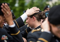 U.S. Army Reserve Soldiers adjust their berets before marching in the 2016 National Memorial Day Parade in Washington, D.C., May 30. Approximately a hundred U.S. Army Reserve Soldiers marched in this year's parade, represented by the 200th Military Police Command, from Fort Meade, Maryland; the 55th Sustainment Brigade, from Fort Belvoir, Virginia; and the Military Intelligence Readiness Command, from Fort Belvoir. (U.S. Army photo by Master Sgt. Michel Sauret)