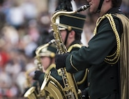 A high school marching band performs along Constitution Avenue in the 2016 National Memorial Day Parade in Washington, D.C., May 30. Approximately a hundred U.S. Army Reserve Soldiers marched in this year's parade, represented by the 200th Military Police Command, from Fort Meade, Maryland; the 55th Sustainment Brigade, from Fort Belvoir, Virginia; and the Military Intelligence Readiness Command, from Fort Belvoir. (U.S. Army photo by Master Sgt. Michel Sauret)