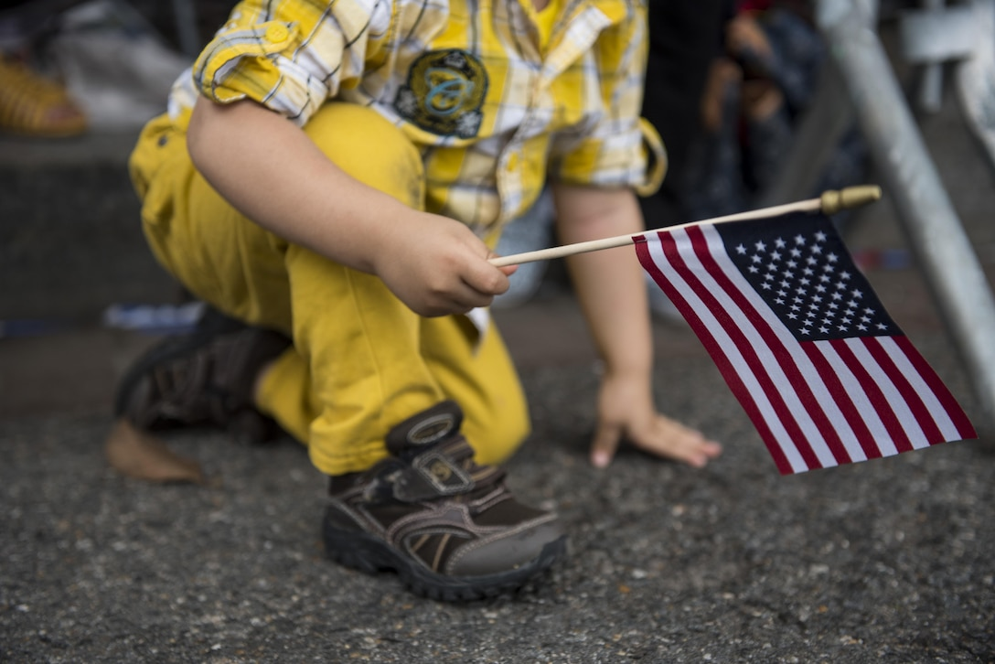 A boy sneaks under a street barrier to get a better view of the 2016 National Memorial Day Parade in Washington, D.C., May 30. Approximately a hundred U.S. Army Reserve Soldiers marched in this year's parade, represented by the 200th Military Police Command, from Fort Meade, Maryland; the 55th Sustainment Brigade, from Fort Belvoir, Virginia; and the Military Intelligence Readiness Command, from Fort Belvoir. (U.S. Army photo by Master Sgt. Michel Sauret)