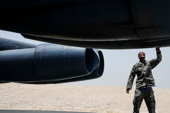Master Sgt. Jeremy Michael Hord, 379th Aircraft Maintenance Squadron aircraft section chief, checks the screws of a B-52 Stratofortress May 20, 2016, at Al Udeid Air Base, Qatar. Hord achieved a career milestone when he launched his third type of bomber, a B-52 Stratofortress, into combat April 14 here. Now, Hord can say he has launched every type of bomber currently serving in the U.S. Air Force's fleet. (U.S. Air Force/Senior Airman Janelle Patiño/Released)