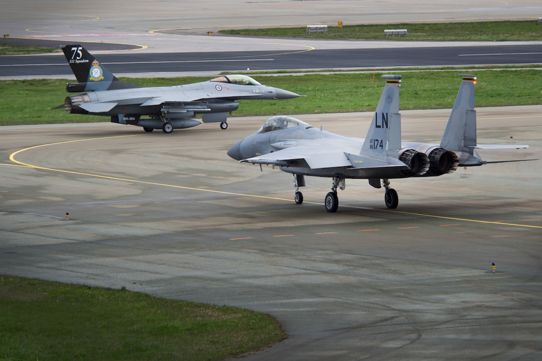 A 493rd Fighter Squadron F-15C Eagle and a Royal Norwegian Air Force F-16 Fighting Falcon taxi to the runway for training exercise Arctic Fighter Meet 2016, Bodø Main Air Station, Norway, May 25, 2016. This training exercise allowed forward-based U.S. Airmen and aircraft from RAF Lakenheath to train with NATO Allies and European partners, building on skill sets and improving every nation's ability to seamlessly work together. (U.S. Air Force photo/Senior Airman Erin Babis/Released)
