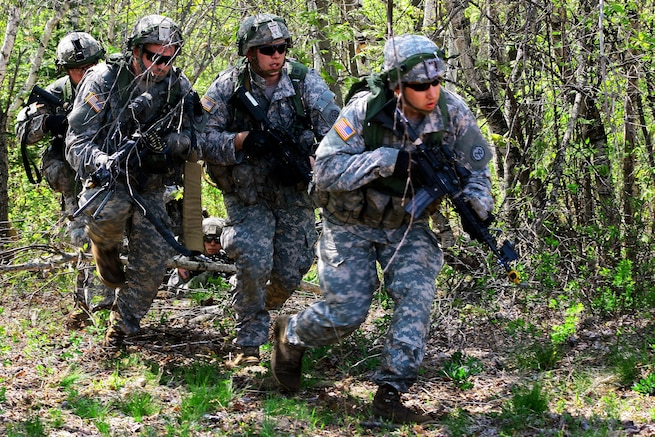 Soldiers maneuver through the woods during a field training exercise at Fort Drum, N.Y., May 20, 2016. Army National Guard photo by Sgt. Alexander Rector