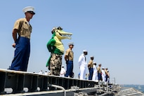 "Marines, sailors and a ""gator"" mascot aboard the USS Bataan man the rails during the parade of ships as part of Fleet Week New York in New York City, May 25, 2016. The Bataan transported more than 500 troops assigned to the 24th Marine Expeditionary Unit to the event. Marine Corps photo by Lance Cpl. Samantha A. Barajas"