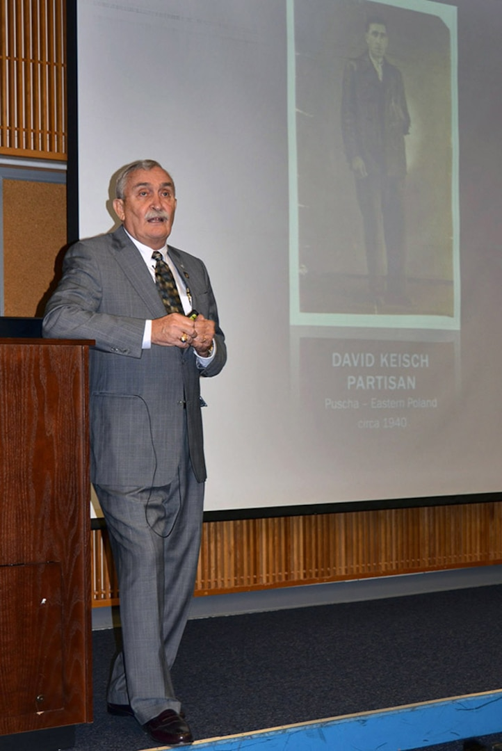 Holocaust refugee and motivational speaker Alex Keisch speaks during Defense Logistics Agency Aviation's Procurement Process Support Directorate's Holocaust Days of Remembrance 2016 program held at the McKeever Auditorium on Defense Supply Center Richmond, Virginia, May 25, 2016.