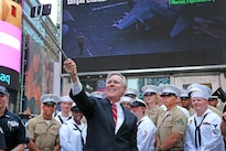 Secretary of the Navy Ray Maybus, center, takes a selfie with sailors and Marines at the Times Square Armed Forces Recruiting Station during Fleet Week New York in New York City, May 26, 2016. Navy photo by Petty Officer 1st Class Aidan P. Campbell