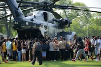 Students tour a static display of an MH-53E Sea Dragon helicopter during Fleet Week New York in New York City, May 26, 2016. The helicopter crew is assigned to Helicopter Mine Countermeasures Squadron 14. Navy photo by Chief Mass Communication Specialist Travis Simmons