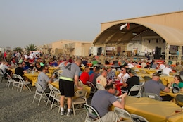 Servicemembers eat steak dinners while listening to a live performance from the Chris Hawkeye Band during a Feed Our Troops event at Camp Arifjan, Kuwait, May 15, 2016. Nearly 3,700 steak dinners were brought from Saint Paul, Minnesota, for Soldiers of the 682nd Engineer Bn., Minnesota National Guard and U.S. Army Central.