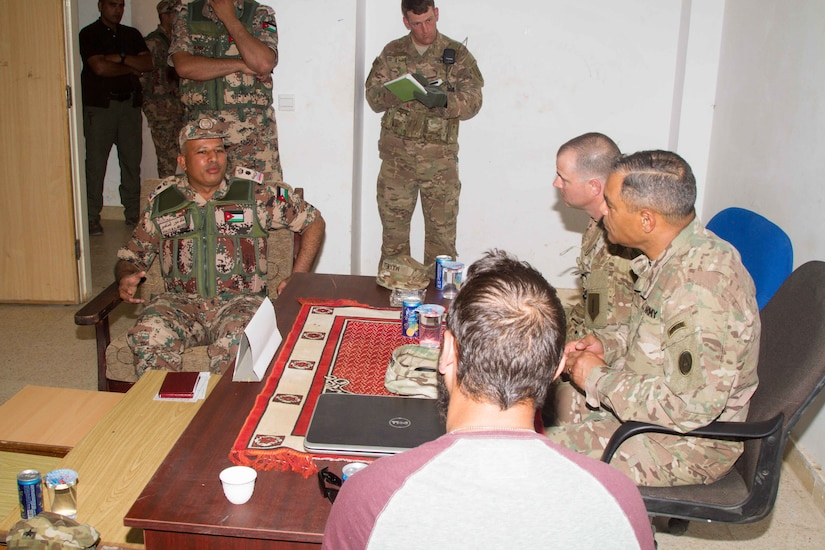 Jordan Army Lt. Col. Khaled M. Al-Mnaseer (left), the commander of the 6th King Ghazi Mechanized Infantry Battalion, briefs U.S. Army Lt. Gen. Michael X. Garrett (right), the commanding general of U.S. Army Central, about the partnership capabilities the Jordanian and U.S. forces have achieved over the past weeks at the Jordanian Training Center, Jordan, April 20. The USARCENT command team met with leaders of partner militaries throughout USARCENT's area of responsibility to continue to build bilateral partnership ties.