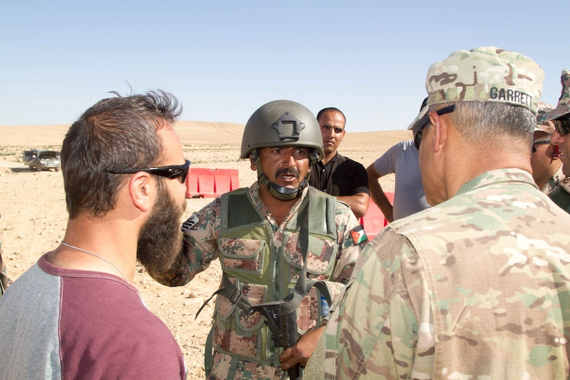 Jordan Army 1st Sgt. Za'l Khalaf (center), a soldier with 6th King Ghazi Mechanized Infantry Battalion, discusses the role of noncommissioned officers in the Jordanian military with Lt. Gen. Michael X. Garrett (right), the commanding general of U.S. Army Central, at the Jordanian Training Center, Jordan, April 20, 2016. The USARCENT command team met with leaders of partner militaries throughout USARCENT's area of responsibility to continue to build bilateral partnership ties.