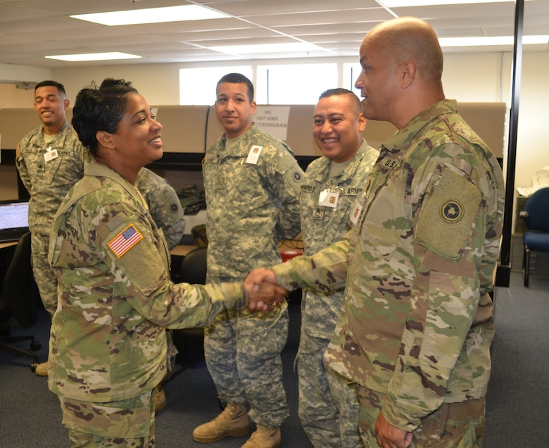 Col. Toni Glover, 650th Regional Support Group commanding officer, visited and greeted Soldiers and Lt. Col. Keven McKenzie, 483rd Transportation Battalion commander, in the 483rd TC BN tactical operations center, during the Operation Terminal Fury exercise May 20. The Operation Terminal Fury exercise tests the abilities of transportation companies with vessel assets to respond quickly to emergencies in their area of responsibility.