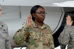 Sgt. Quenisha Gonzales, a Dudley, N.C. native, takes the oath of enlistment during a reenlistment ceremony May 20, 2016 at Shaw Air Force Base, S.C. Lt. Col. Christopher Hammond, commander of the U.S. Air Force Thunderbirds, performed the ceremony during the Shaw Air Expo & Open House.