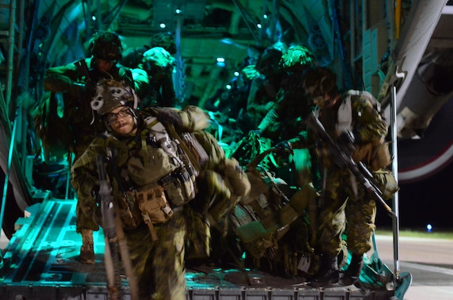 Canadian Soldiers with 3rd Battalion Princess Patricia's Canadian Light Infantry hustle out of a C-130 aircraft during a Tactical Air Landing Operation (TALO) at the recently seized Canadian Forces Base Cold Lake, as part of Exercise Maple Resolve, May 27, 2016.  Several hours prior to the TALO, 3rd Battalion's airborne infantry had jumped and seized CFB Cold Lake to pave the way for further air operations. (U.S. Army Sgt. William A. Parsons, 214th Mobile Public Affairs detachment)(Released)
