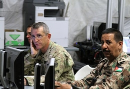 Maj. Gen. William Hickman, for U.S. Army Central deputy commanding general-operations, and Brig. Gen. Mekhled Suheim, Eager Lion 16 Combined Forces Land Component Command deputy commander, receive an operation and intelligence update brief during Eager Lion 16 at the Joint Training Center, Jordan, May 23, 2016. Eager Lion is an annual, bilateral exercise that took place taking place in the Hashemite Kingdom of Jordan between the Jordanian Armed Forces and the U.S. Military that is designed to strengthen relationships between the partner nations.