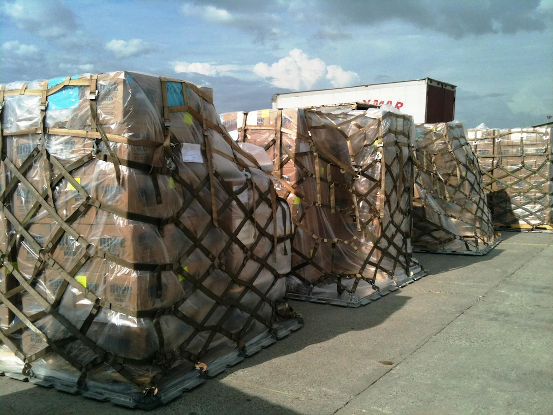 Fifteen pallets of rice and beans, equating to 615,000 meals, sit on the tarmac in Port-Au-Prince after being unloaded from a 445th Airlift Wing C-17 Globemaster III May 26, 2016. The food items, provided by Kids Against Hunger, a ministry of A Child's Hope International from Cincinnati, Ohio, were delivered to the impoverished country through the Denton Program.