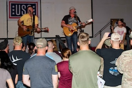 Jerrod Neimann (center), a country music artist, preforms for Soldiers of U.S. Army Central as part of the USO May Madness Tour on Camp Arifjan, Kuwait, May 18, 2016. The celebreties on the tour said they wanted to repay Servicemembers for their sacrifice and dedication to America.