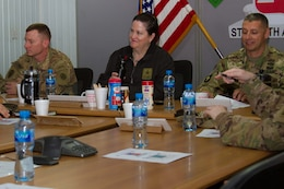 The Honorable Katherine Hammack, the assistant secretary of the Army for installations, energy and environment, Brig. General John S. Laskodi, with the Department of the Army Headquarters logistics office and Col. Jeff Stewart, commander of Area Support Group-Kuwait, prepare for a briefing in a conference room at the Kuwait Naval Base, Kuwait, May, 24, 2016. The delegation received a brief on partnership opportunities with Kuwaiti military and installation operations before visiting sites on the base.