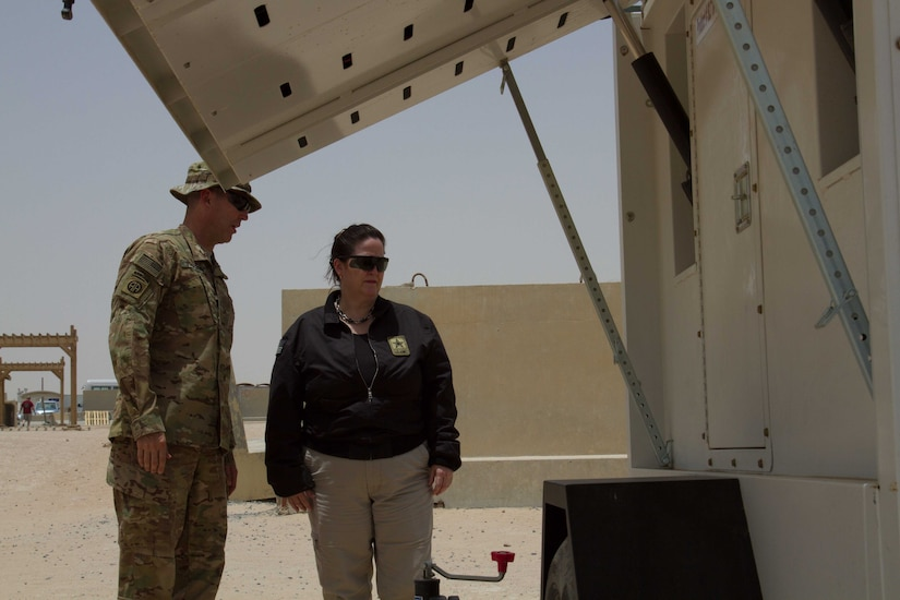 Lt. Col. Lee Johnson, the Camp Buehring base commander, briefs the Honorable Katherine Hammack, the assistant secretary of the Army for installations, energy and environment, on the solar powered light system project at bases throughout the U.S. Army Central area of responsibility May, 24, 2016. USARCENT plans to replace diesel powered light systems with the more energy efficient solar-powered systems.