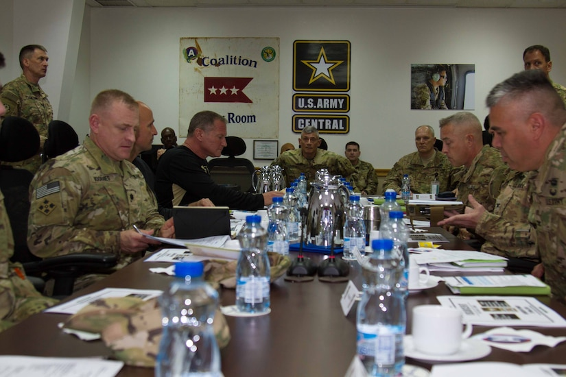 Lt. Gen. Robert L. Caslen Jr., the superintendent of the United States Military Academy at West Point, takes a seat in preparation for an operations brief at the U.S. Army Central Headquarters at Camp Arifjan, Kuwait, May 28, 2016. Caslen and members of the school's athletic department visited with graduates from West Point to get feedback from their time at the academy and how it affects the work they now do in the Army.