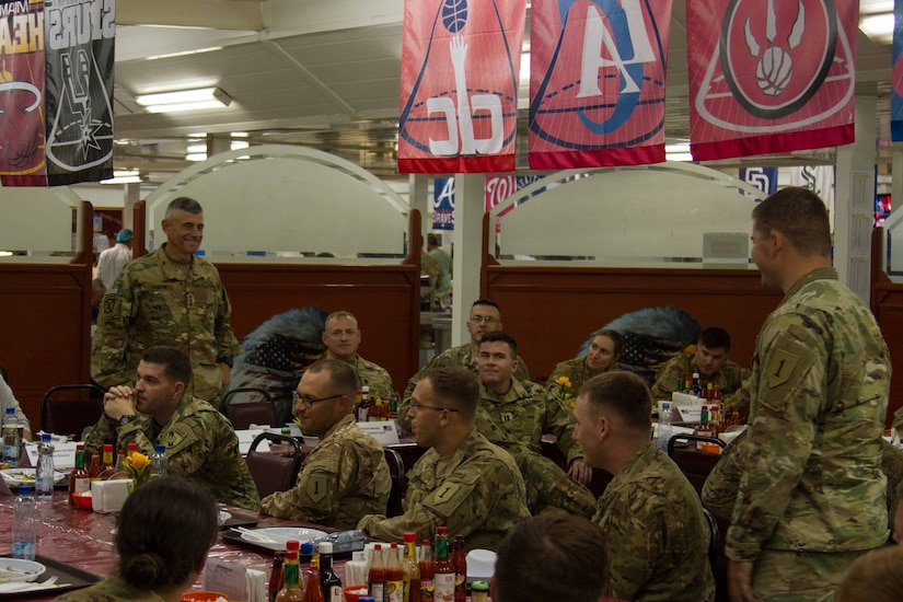 Lt. Gen. Robert L. Caslen Jr., the superintendent of the United States Military Academy at West Point, speaks with 2nd Lt. Daniel Engstrom, an intelligence officer, with 2nd Battalion, 70th Armored Regiment, 2nd Armored Brigade Combat Team, 1st Infantry Division and other graduates of West Point during dinner at Camp Buehring, Kuwait, May 28, 2016. Caslen and members of the school's athletic department visited with graduates from West Point to get feedback from their time at the academy and how it affects the work they now do in the Army.